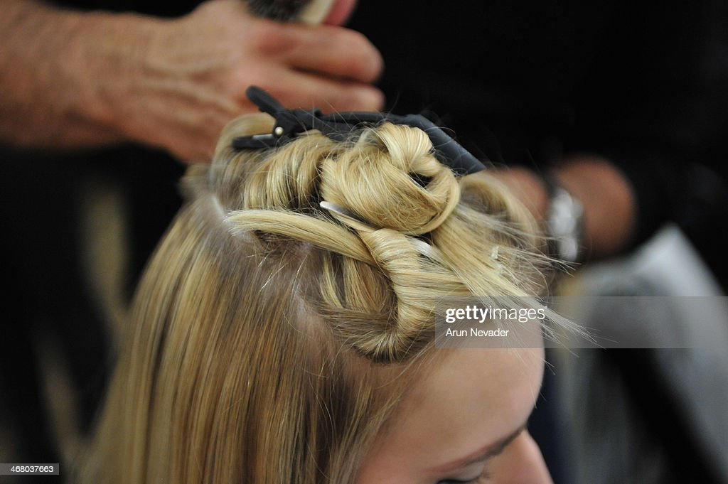 A model prepares backstage before the Kaelen presentation during Mercedes-Benz Fashion Week Fall 2014 at Highline Stages on February 8, 2014 in New York City.