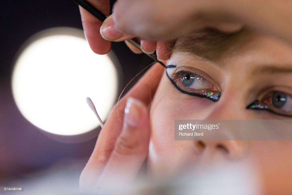 A model prepares backstage before the Kenzo show as part of the Paris Fashion Week Womenswear Fall/Winter 2016/2017 on March 8 2016 in Paris France
