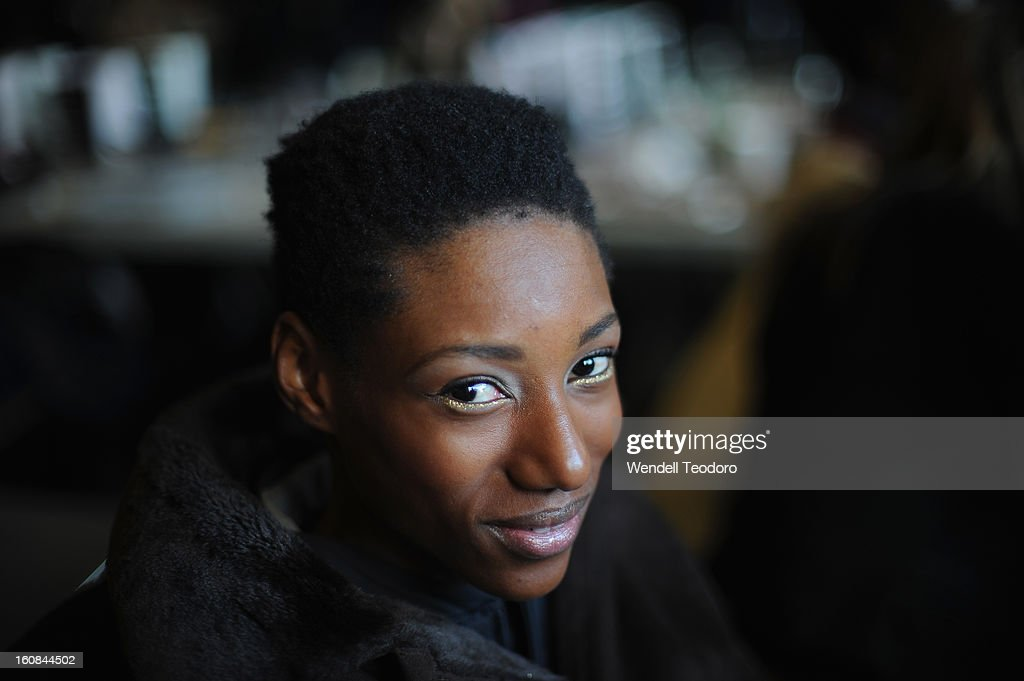 A model prepares backstage before the Rita Vinieris Debut Eveningwear Collection presentation during Fall 2013 Mercedes-Benz Fashion Week at the Baryshnikov Arts Center on February 6, 2013 in New York City.
