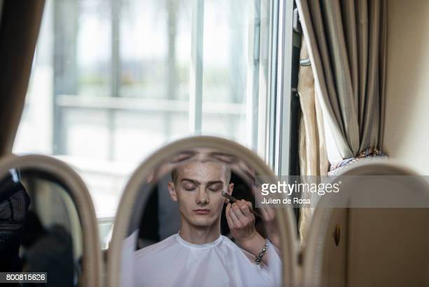 A model prepares backstage before the Rynshu Menswear Spring/Summer 2018 show as part of Paris Fashion Week on June 25 2017 in Paris France