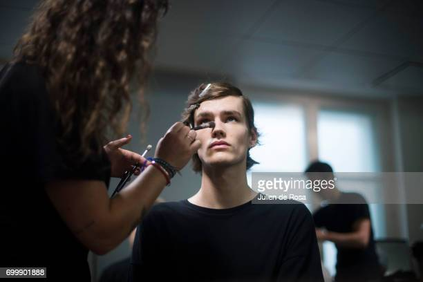 A model prepares backstage before the Sean Suen Menswear Spring/Summer 2018 show as part of Paris Fashion Week on June 22 2017 in Paris France