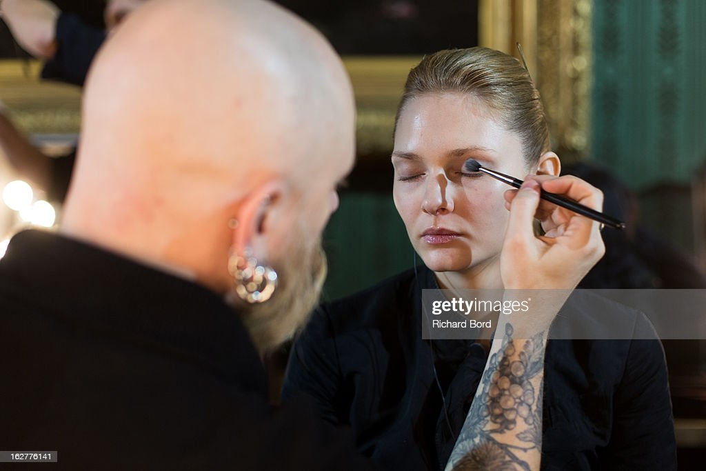 A model prepares backstage before the Steffie Christiaens Fall/Winter 2013 Ready-to-Wear show as part of Paris Fashion Week on February 26, 2013 in Paris, France.