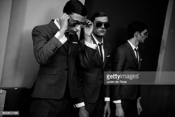 A model prepares backstage before the Thom Browne Menswear Spring/Summer 2018 show as part of Paris Fashion Week on June 25 2017 in Paris France