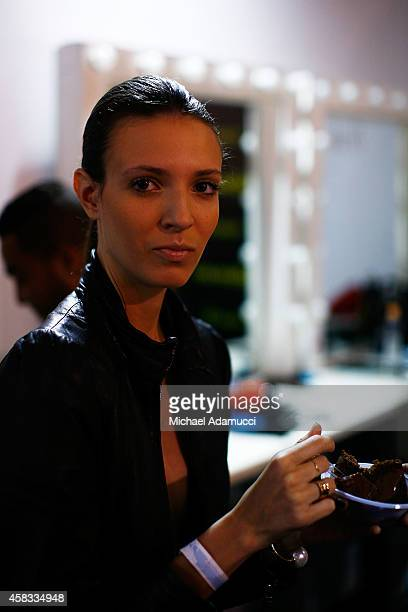 A model prepares backstage before the Uma Raquel Davidowicz fashion show during Sao Paulo Fashion Week Winter 2015 at Parque Candido Portinari on...