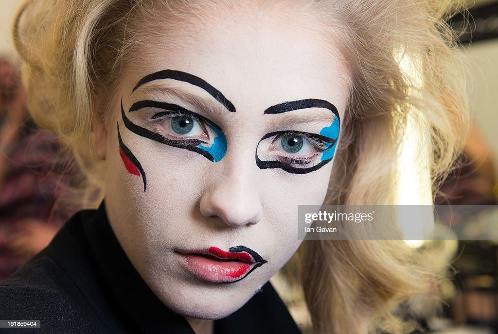 A model prepares backstage before the Vivienne Westwood Red Label show during London Fashion Week Fall/Winter 2013/14 at the Saatchi Gallery on February 17, 2013 in London, England.