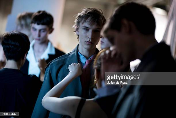 A model prepares backstage before the Wooyoungmi Menswear Spring/Summer 2018 show as part of Paris Fashion Week on June 24 2017 in Paris France