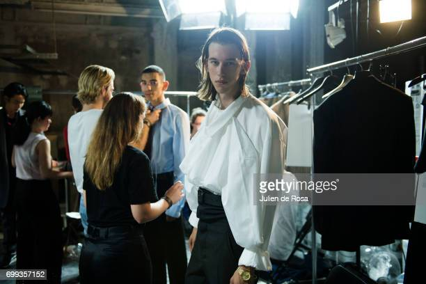 A model prepares backstage before the Y/Project Menswear Spring/Summer 2018 show as part of Paris Fashion Week on June 21 2017 in Paris France