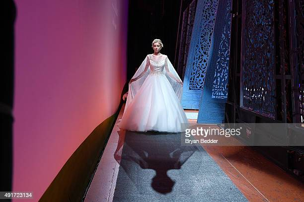 A model prepares backstage during 2016 Alfred Angelo Disney Fairy Tale Weddings Bridal Collection fashion show debut at New Amsterdam Theatre on...