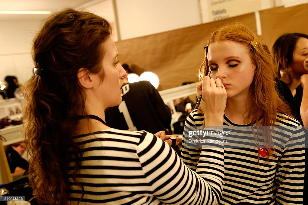 A model prepares backstage during Diane Von Furstenberg Fall 2016 during New York Fashion Week on February 14, 2016 in New York City.