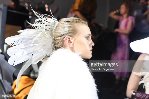 A model prepares backstage during Esmod Paris Show 'This Is Us' on June 15 2017 in Paris France