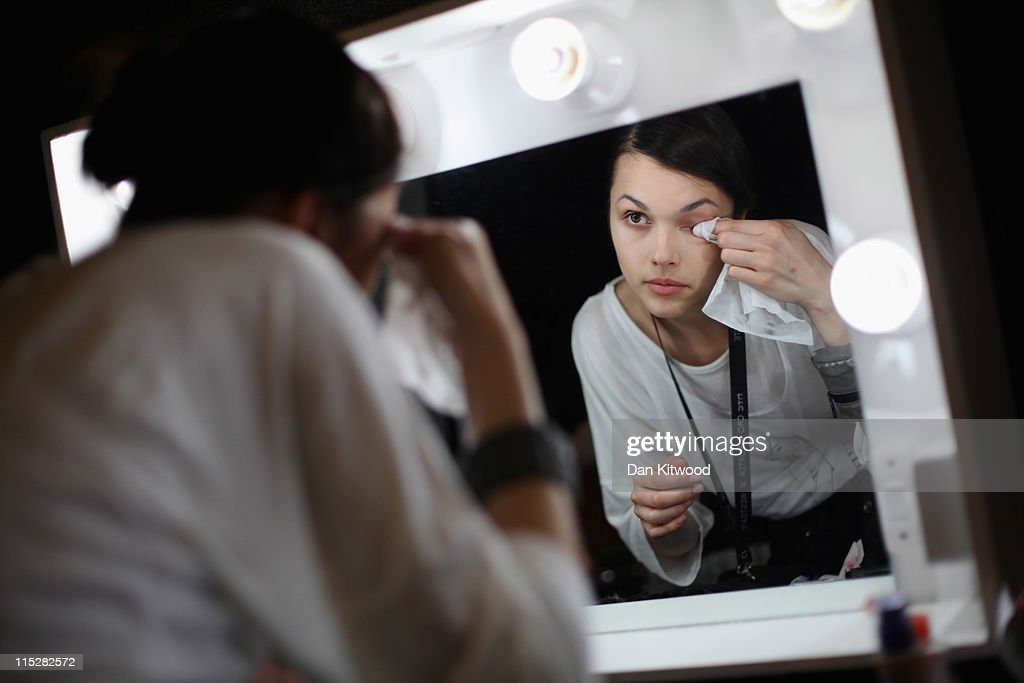 A model prepares backstage during Graduate Fashion Week at Earls Court on June 6, 2011 in London, England. The event which began in 1991 showcases emerging talent from BA Graduate fashion design courses across the UK and includes exhibition stands and catwalk shows from around 50 universities.