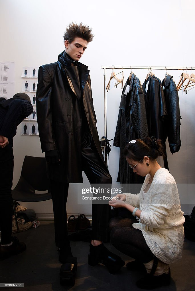 A model prepares backstage during the Alibellus + Men Autumn / Winter 2013 show as part of Paris Fashion Week at Maison des Metallos on January 16, 2013 in Paris, France.