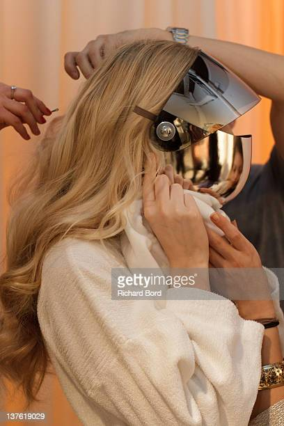A model prepares backstage during the Jantaminiau HauteCouture 2012 show as part of Paris Fashion Week at Le Laboratoire on January 23 2012 in Paris...