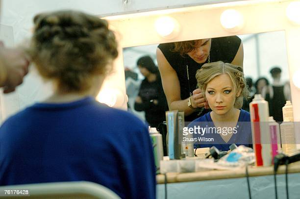 A model prepares backstage during the Top Shop employees summer party at Hedsor House on August 16 2007 in Taplow Essex