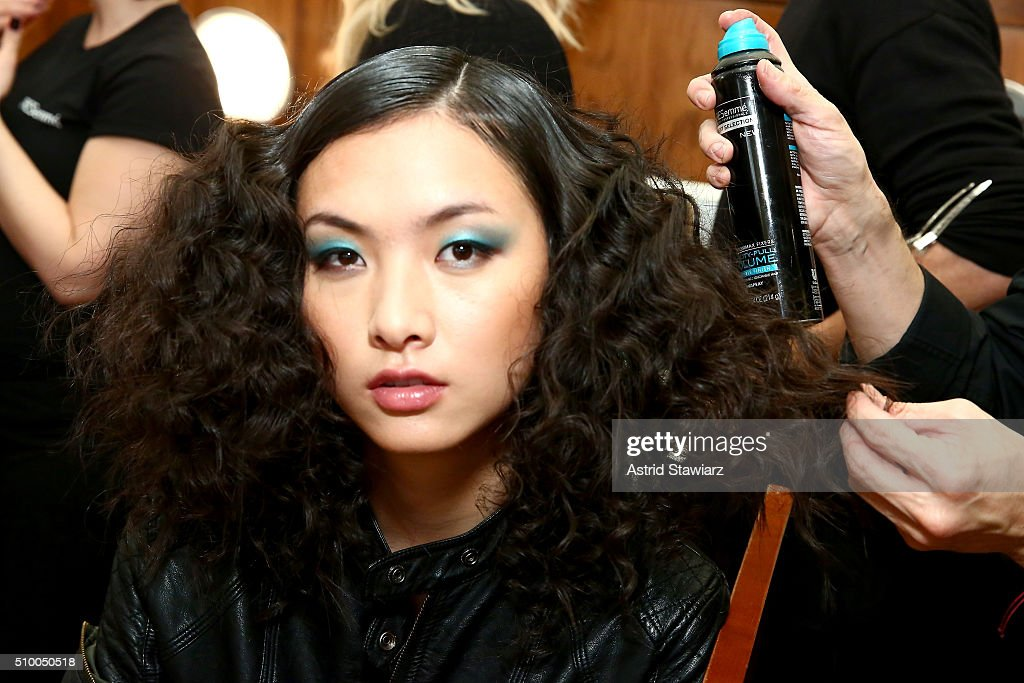 A model prepares backstage during the TRESemme at Mara Hoffman A/W16 Presentation at High Line Hotel, The Refectory on February 13, 2016 in New York City.