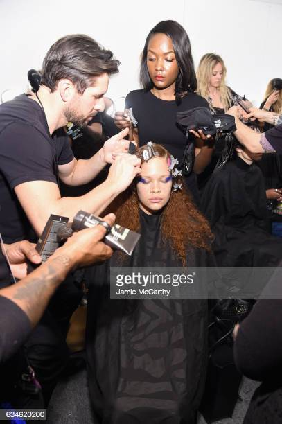 A model prepares backstage for the Chromat collection during New York Fashion Week The Shows at Gallery 3 Skylight Clarkson Sq on February 10 2017 in...