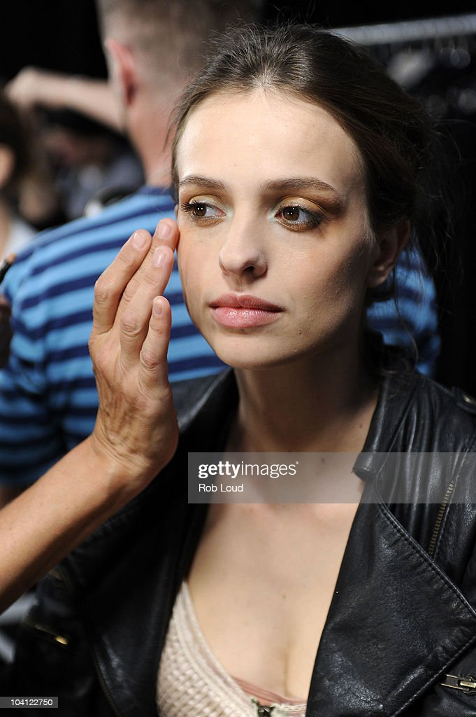 A model prepares backstage for the G-Star Spring 2011 fashion show during Mercedes-Benz Fashion Week at Pier 94 on September 14, 2010 in New York City.