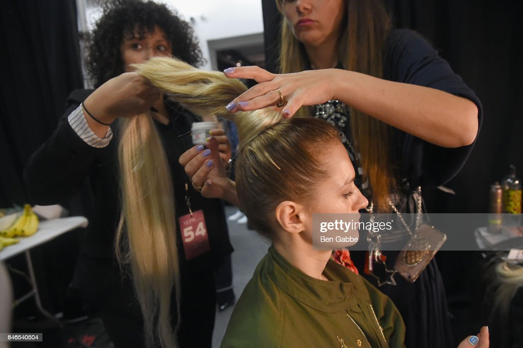 A model prepares backstage for the Zang Toi fashion show during New York Fashion Week: The Shows at Gallery 3, Skylight Clarkson Sq on September 13, 2017 in New York City.