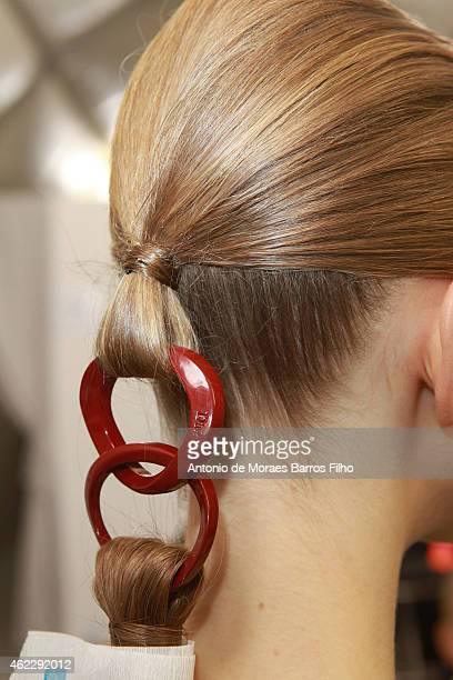 A model prepares backstage prior to Christian Dior show as part of Paris Fashion Week HauteCouture Spring/Summer 2015 on January 26 2015 in Paris...