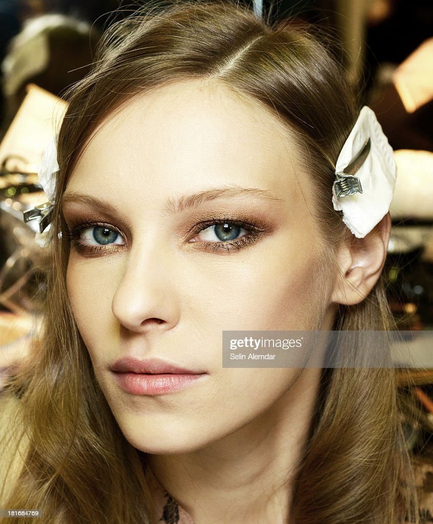 A model prepares backstage prior to Genny fashion show as a part of Milan Fashion Week Womenswear Spring/Summer 2014 at on September 23, 2013 in Milan, Italy.