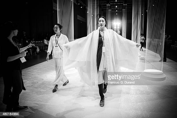 A model prepares backstage prior to Lan Yu show as part of Paris Fashion Week HauteCouture Fall/Winter 2015/2016 on July 9 2015 in Paris France