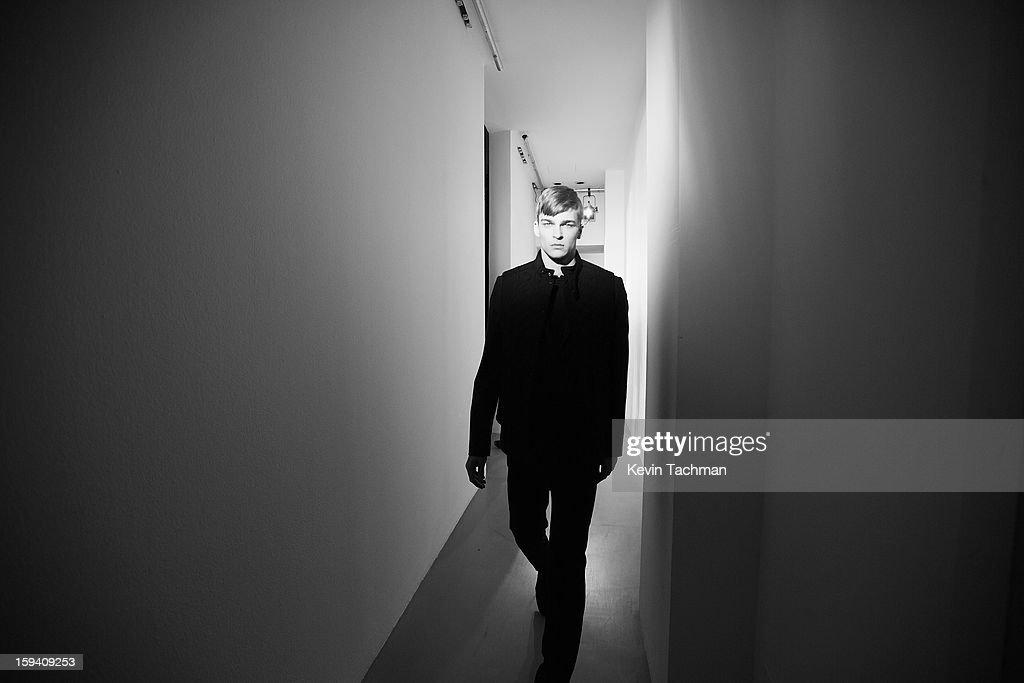 A model prepares backstage prior to the Calvin Klein Collection show as part of Milan Fashion Week Menswear Autumn/Winter 2013 on January 13, 2012 in Milan, Italy.