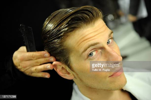 Model prepares backstage prior to the Dirk Bikkembergs fashion show as part of Milan Fashion Week Menswear Autumn/Winter 2012 on January 16 2012 in...