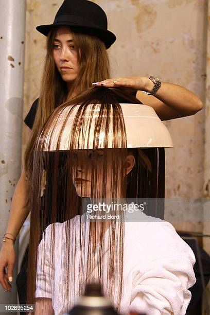A model prepares backstage prior to the Jantaminiau show as part of Paris Fashion Week Fall/Winter 2011 at BETC EURO RSCG on July 7 2010 in Paris...