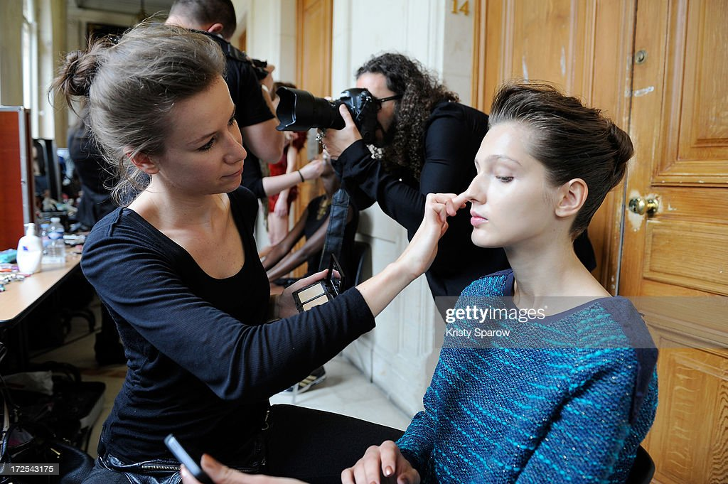 A model prepares backstage prior to the Serkan Cura Couture show as part of Paris Fashion Week Haute-Couture Fall/Winter 2013-2014 at Mairie du 4e on July 3, 2013 in Paris, France.