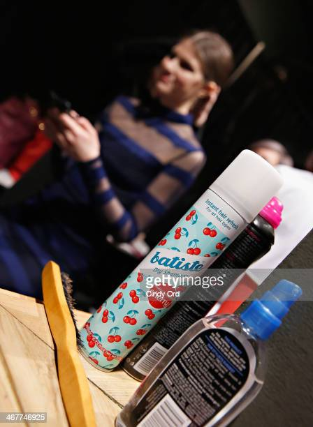 A model prepares backstage with Batiste Dry Shampoo at the Charlotte Ronson Fall 2014 Presentation during MercedesBenz Fashion Week at The Hub at The...