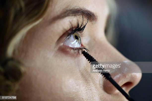 A model prepares backstage with her make up applied during the MercedesBenz Fashion Week Istanbul Autumn/Winter 2016 at Zorlu Center on March 15 2016...