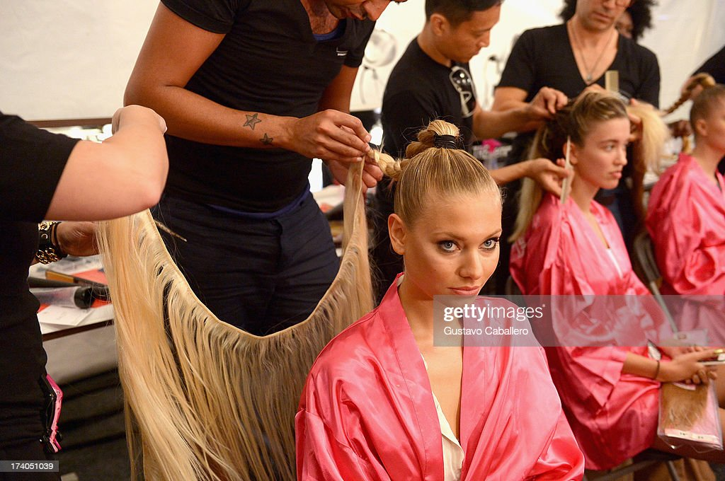 A model prepares backstage with TRESemme at the Beach Bunny show during Mercedes-Benz Fashion Week Swim 2014 at Cabana Grande at the Raleigh on July 19, 2013 in Miami, Florida.