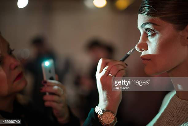 Model prepares before the Corrie Nielsen show as part of the Paris Fashion Week Womenswear Spring/Summer 2015 on September 23 2014 in Paris France