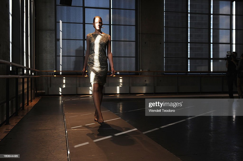 A model prepares before the Rita Vinieris Debut Eveningwear Collection presentation during Fall 2013 Mercedes-Benz Fashion Week at the Baryshnikov Arts Center on February 6, 2013 in New York City.
