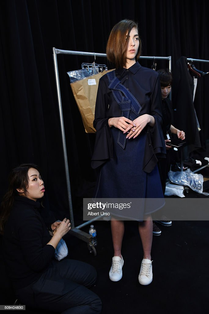 A model prepares for the Claudia Li presentation during New York Fashion Week Women's Fall/Winter 2016 at ArtBeam on February 10, 2016 in New York City.