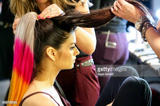 A model prepares in makeup and hair backstage ahead of the FW Trends Runway as part of the Mercedes Benz Fashion Festival Sydney 2012 at Sydney Town...