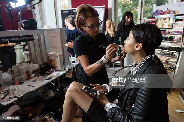 A model prepares prior to the Kaviar Gauche show as part of the Paris Fashion Week Womenswear Spring/Summer2016 at Salon FranceAmeriques on October 4...