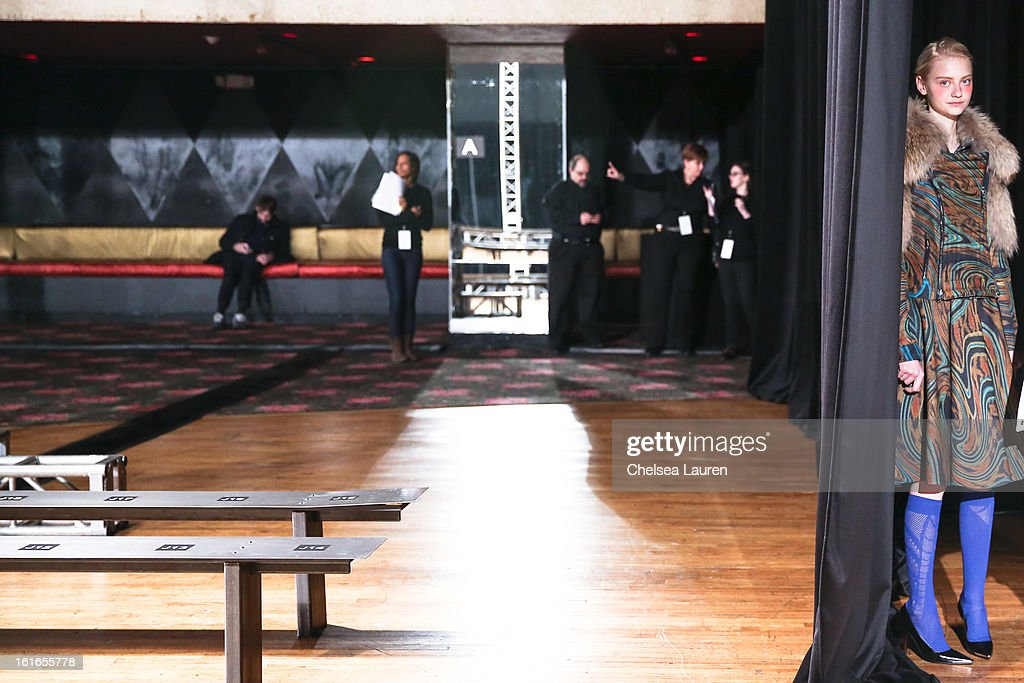 A model prepares to rehearse at the Philosophy By Natalie Ratabesi fall 2013 fashion show during Mercedes-Benz Fashion Week at Roseland Ballroom on February 13, 2013 in New York City.