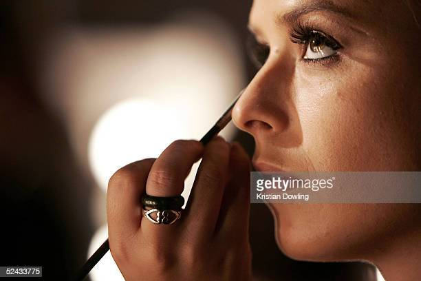 A model preparing before walking down the catwalk during the L'Oreal Paris Runway 4 of the L'Oreal Fashion Festival at Federation Square March 16...