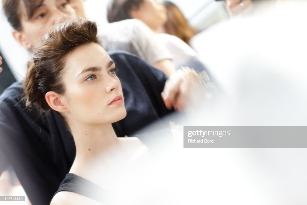A model preprares backstage before the Bouchra Jarrar HauteCouture Show as part of Paris Fashion Week Fall/Winter 2013 at Musee Bourdelle on July 2...