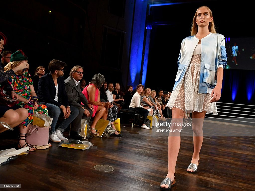 A model present a creation by German designer Marcel Ostertag during the Spring/Summer 2017 collections at the Fashion Week in Berlin on June 30, 2016. / AFP / dpa / Jens Kalaene / Germany OUT