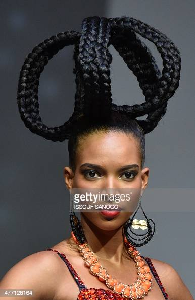 A Model Present A Hair Creation By Ivory Coast 39 S Hairstyles Dieudonne Senato During The 10th