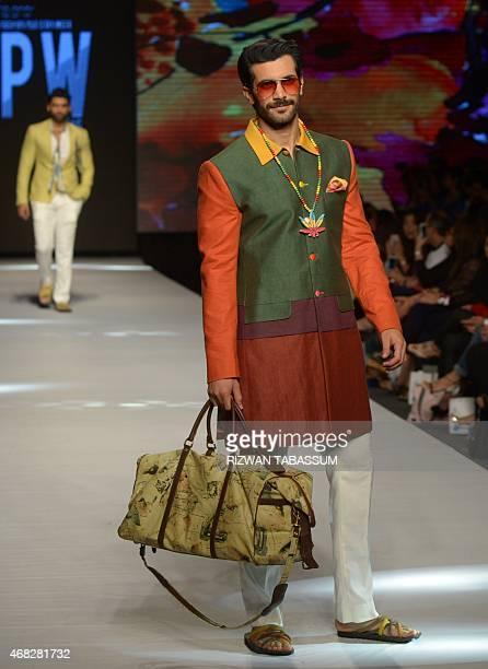 Model present the creation by designer Abdul Samad at the Fashion Pakistan Week in Karachi on April 1 2015 AFP PHOTO / Rizwan TABASSUM