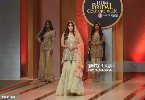 Model present the creation by designer Uzma Babar on the second day of Fashion Bridal Couture Week in Karachi on April 1 2017 / AFP PHOTO / RIZWAN...