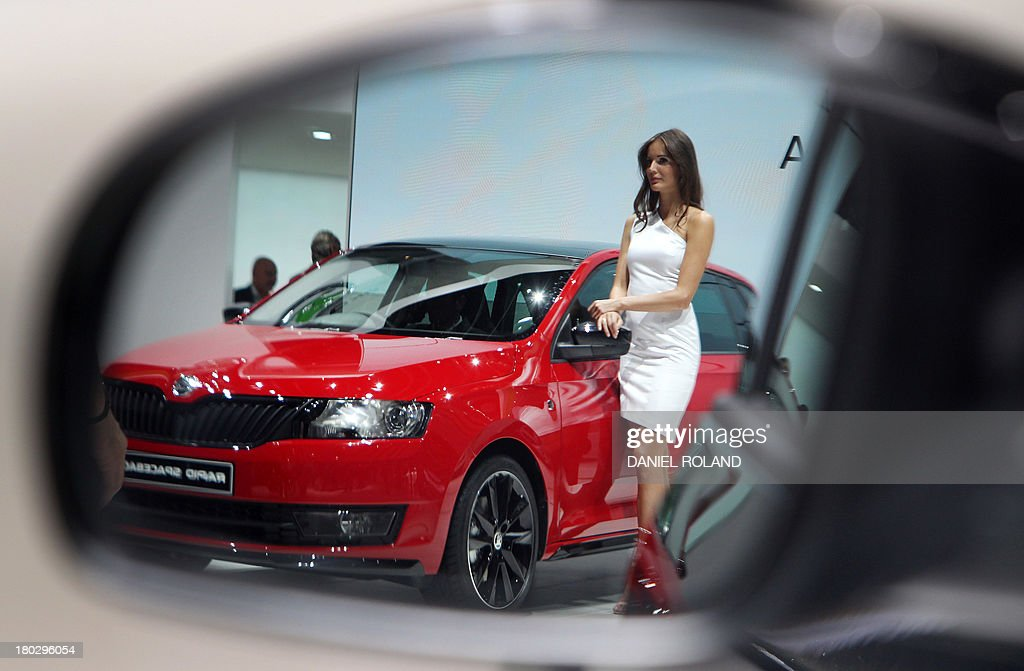 A model presenting a Skoda Rapid is refelected in a rearview mirror of a car at the IAA (Internationale Automobil Ausstellung) in Frankfurt/Main,central Germany, on September 11, 2013. According to the organiser, more than 1,000 exhibitors from 35 countries will present their products during the show running from September 12 to 22, 2013.