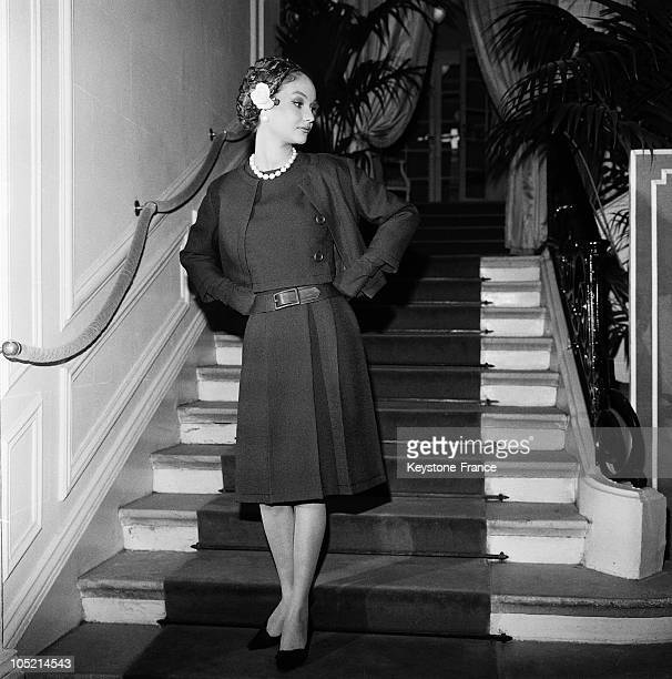 Model Presenting An Outfit From Christian Dior'S SpringSummer Collection In Paris On February 16 1962 This Outfit Made Of Navy Blue Wool And A...