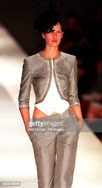 A model presents a black and white chequered matadorstyle jacket and matching belowtheknee trousers designed by Antonio Berardi during London Fashion...