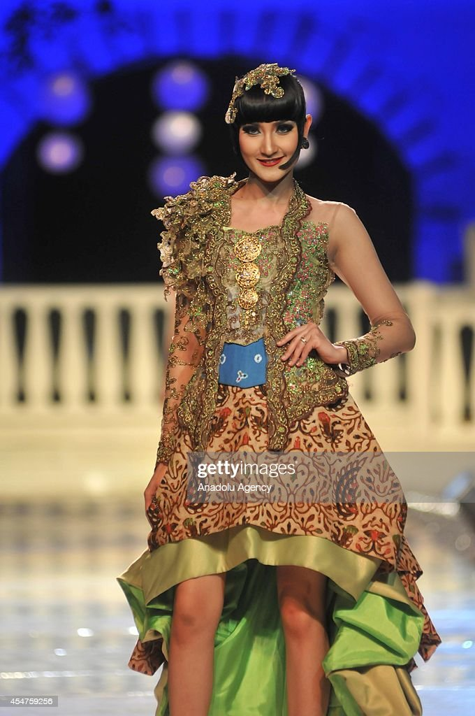 A model presents a costume during the first day of the 6th Solo Batik Fashion Carnival in Surakarta Central Java Indonesia on September 05 2014