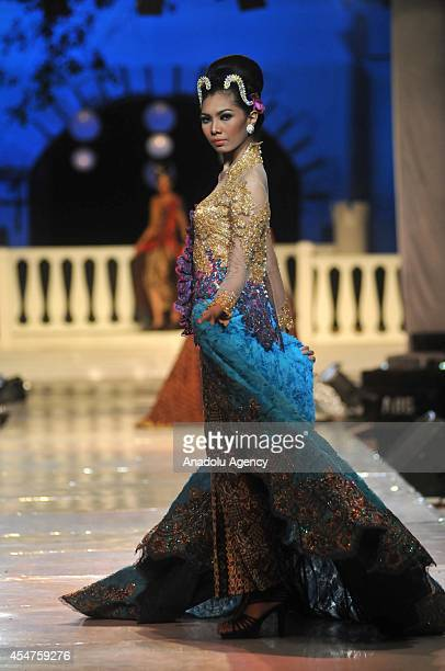 A model presents a costume during the first day of the 6th Solo Batik Fashion in Surakarta Central Java Indonesia on September 05 2014
