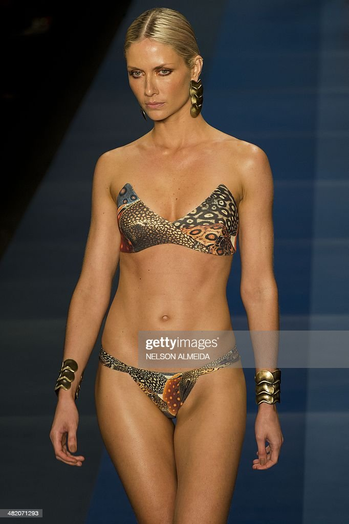 A model presents a creation by Agua de Coco during the 2015 Summer collections of the Sao Paulo Fashion Week in Sao Paulo, Brazil, on April 2, 2014. AFP PHOTO / Nelson ALMEIDA